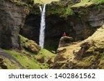 kvernufoss waterfall in the... | Shutterstock . vector #1402861562