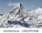 unusual view of Matterhorn from south  face in a bright winter day with a good weather with a little bit clouds nearby
