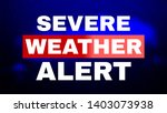Severe Weather Alert. Image for Article, Post, Website. Warning caution danger notification. White text on blue background with dark clouds and drops of rain. Communication and risk concept. - stock photo