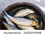 Stock photo fish in a wooden barrel salted herring at the seafood market 1403194448