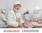 Elderly Man Working On Butchery....