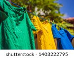 Stock photo multicolor shirts on clothesline in sunny day 1403222795