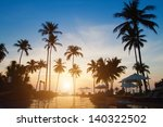 Silhouettes Of Palm Trees On...