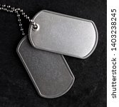 old and worn military dog tags  ... | Shutterstock . vector #1403238245