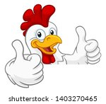 Stock photo a chicken rooster cockerel bird cartoon character peeking over a sign and giving a double thumbs up 1403270465