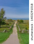 footpath to the beach at the... | Shutterstock . vector #1403291018