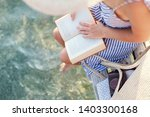 Woman Is Reading Paper Book On...