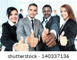 happy business team with thumbs ... | Shutterstock . vector #140337136