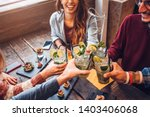 Stock photo happy friends drinking mojito at bar restaurant concept about young people having fun 1403406068
