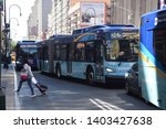 Small photo of NEW YORK, NEW YORK-MAY 2019: Crosstown buses on 14th street, being used to help commuters get across town as L train repairs begin, clog up the street on a weekend.