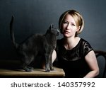 Portrait of an adult Woman with her purebred Russian Blue Cat - stock photo
