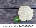 Raw Cauliflower On Wooden...