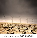 Wind Farm in a barren cracked desert - stock photo