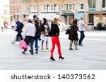 picture in motion blur of people on the move in the city - stock photo