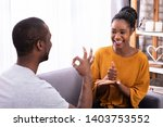 smiling young couple sitting on ...   Shutterstock . vector #1403753552