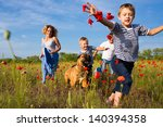 Stock photo family of four person playing on the poppy field 140394358