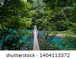 Small photo of Woody suspension bridge over Ohma Dam Lake of Sumatakyo Canyon located in Kawane Honcho in Shizuoka Prefecture