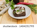 Stock photo open sandwich made of brown bread and slices of fillet of pickled atlantic herring on saucer among 1404251795