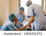 surgeons checking on the... | Shutterstock . vector #1404291572