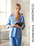 female medical assistant in... | Shutterstock . vector #1404294212