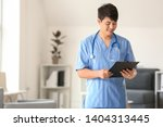 male medical assistant with... | Shutterstock . vector #1404313445