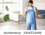 male medical assistant with... | Shutterstock . vector #1404313448