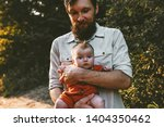father with baby walking in... | Shutterstock . vector #1404350462