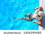 sexy woman in bikini and sunhat ...   Shutterstock . vector #1404399485