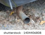 a rusty old exhaust pipe on a... | Shutterstock . vector #1404406808