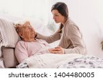 young daughter supporting sick... | Shutterstock . vector #1404480005