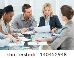 group of coworkers discussing... | Shutterstock . vector #140452948