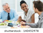 business colleagues eating meal ... | Shutterstock . vector #140452978