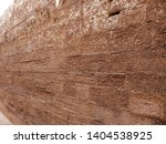 ancient red stone brick wall... | Shutterstock . vector #1404538925