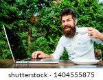 bearded man freelance worker.... | Shutterstock . vector #1404555875