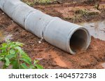 concrete drainage pipe on a... | Shutterstock . vector #1404572738