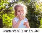 girl in a smart dress with lilac | Shutterstock . vector #1404573332