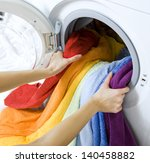 woman taking color  clothes... | Shutterstock . vector #140458882