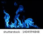 blue smoke isolated on a black... | Shutterstock . vector #1404594848