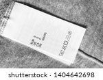 s size and care clothes label... | Shutterstock . vector #1404642698