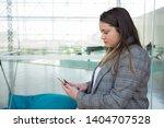 serious business woman using... | Shutterstock . vector #1404707528