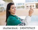side view of pretty young mixed ... | Shutterstock . vector #1404707615