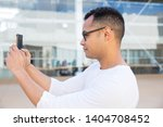 serious young guy taking selfie ... | Shutterstock . vector #1404708452