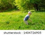 little boy side view. he is... | Shutterstock . vector #1404726905