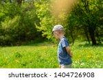 little boy side view. he is... | Shutterstock . vector #1404726908