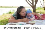 beautiful young mother plays in ... | Shutterstock . vector #1404744338