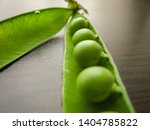 closeup of fresh green peas on... | Shutterstock . vector #1404785822