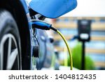electric car is charging on...   Shutterstock . vector #1404812435