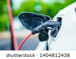 electric car is charging on...   Shutterstock . vector #1404812438