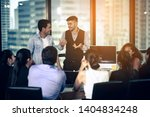 the business team is discussing ... | Shutterstock . vector #1404834248