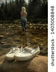 White Shoes On A Rock In The...